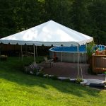 20'x20' Frame Tent Over Patio by Pool