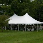 30'x45' Pole Tent with white party chairs