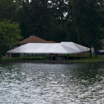 30'x60' Frame Tent with married 30'x40' Frame Tent by lake