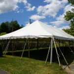 30x90 Pole Tent with stone wall Behind it