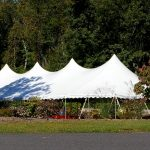 40x100 Pole Tent with bronze statue in front