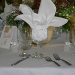 Simple Buffet Table Setting with Water Goblet, Wine Glass, and White Napkin set prior to a wedding