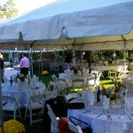 Frame tents with tables set before a wedding