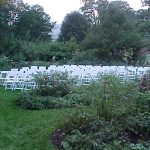 White Party Chairs set for Wedding Ceremony in a Garden