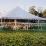 White Party Chairs set for Wedding Ceremony under a Tent